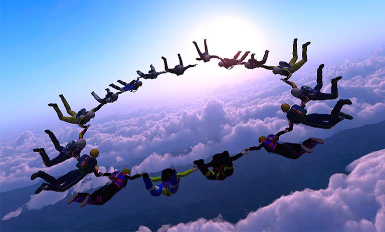 grupo de personas lanzándose en paracaídas